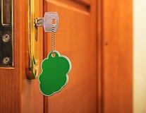 Key in keyhole Stock Photos