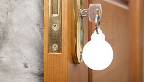 Key in keyhole. With blank label shape Christmas ball Royalty Free Stock Photos