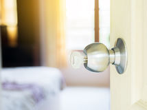 Key in keyhole with door open Royalty Free Stock Image
