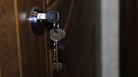 Key in keyhole on door stock footage