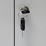 A key in keyhole with locking a cabinet Stock Photography