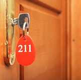 Key in keyhole with number Royalty Free Stock Photos