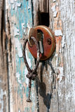 Key in keyhole on old door Royalty Free Stock Photo