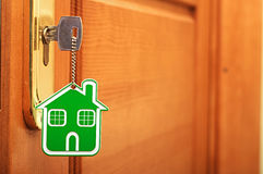 Key in keyhole. Symbol of the house and stick the key in the keyhole Stock Photo