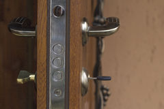 Key in the keyhole. In the wooden door Royalty Free Stock Photo