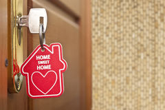 Key with label home. Key in keyhole with label home Royalty Free Stock Photo