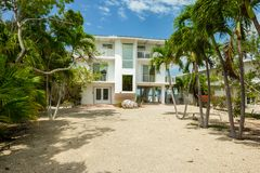 Key Largo Home. Key Largo, Florida - May 30, 2018: Typical waterfront style vacation home in the popular upper Florida Keys near Miami stock image