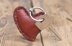Key with leather trinket. On wooden background Royalty Free Stock Images