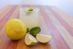 Key lime margarita garnished with fresh lime in a glass bar table Royalty Free Stock Photography