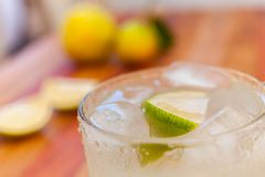 Key lime margarita garnished with fresh lime in a glass. Close up. Stock photo stock photography
