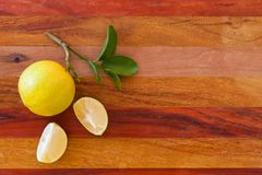 Key lime or Mexican lime on wooden table, one of main ingredient thai food and traditional pie. horizontal Royalty Free Stock Image