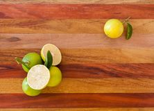 Key lime or Mexican lime on wooden table, one of main ingredient thai food and traditional pie. horizontal Royalty Free Stock Photo