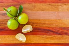 Key lime or Mexican lime on wooden table, one of main ingredient thai food and traditional pie. horizontal Stock Photography