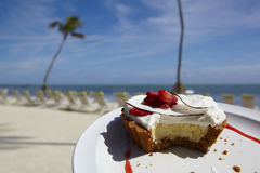 Key Lime Pie. With tropical setting in the background Royalty Free Stock Photography