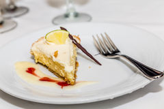 Key Lime Pie with Garnish and Sauce. Key Lime Pie with chocolate Garnish and Sauce stock photos