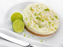 Key Lime pie with limes Royalty Free Stock Image