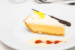 Key Lime Pie with Sauce Royalty Free Stock Photography