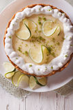 Key lime pie with whipped cream close-up. vertical top view. Key lime pie with whipped cream close-up on a plate. vertical top view royalty free stock images
