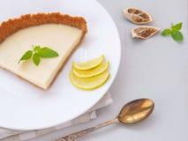 Key lime pie with white chocolate. Homemade lemon tart. Selective focus. stock image