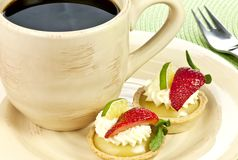 Key lime tarts and a cup of coffee Royalty Free Stock Photos