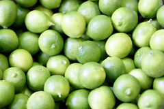Key Limes. Displayed at a produce market Stock Photos