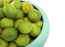 Key limes. Bowl of fresh key limes royalty free stock images