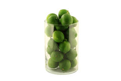 Key Limes in Glass Cylinder on white. Stock Image