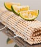 Key Limes On Bamboo Mat Stock Image