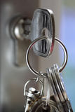 Key in a lock. Unlocking a house door with a key on a keyring Stock Photo