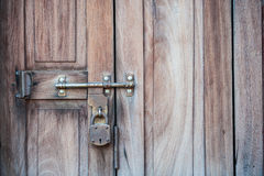 Key lock. A key lock on the wooden wall stock images