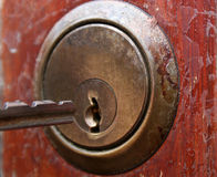 Key in lock. Key being put into doorlock Royalty Free Stock Photography