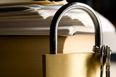 Key lock and a book Royalty Free Stock Photography