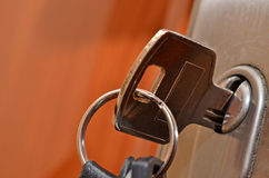 Key in lock close up Stock Images