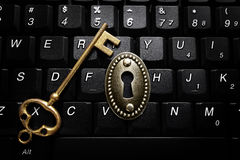 Key and lock on computer keyboard Stock Images
