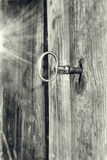 Key in lock grey grunge Stock Images