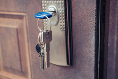 The key in the lock of the iron door. Royalty Free Stock Images