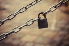 Key lock locked with a chain Stock Photo
