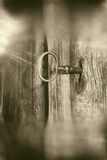 Key in lock sepia grunge Royalty Free Stock Photography