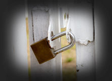 Key lock at white fence for protection asset. Royalty Free Stock Photo