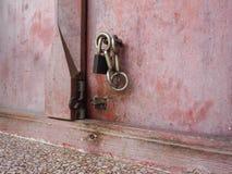 Key lock wooden door Royalty Free Stock Image