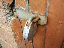 Key locked on hinges. On the wooden door Royalty Free Stock Photo