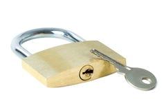 Key and a locked padlock showing keyhole Royalty Free Stock Photo