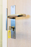 Key locks office door Royalty Free Stock Photos