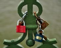 Key of love. Lovers put together a lock at the bridges and throw the key into the river Isar as a sign of their everlasting love royalty free stock image