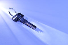 Key lying in a shaft of light Royalty Free Stock Photo