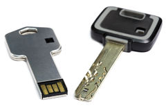 Key mechanical, crack-resistant, with high extent of protection, and a key electronic with a microchip Stock Photos