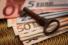 Key and money Stock Photos