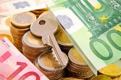 Key and money Royalty Free Stock Photos