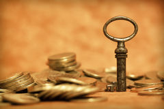 Key and money coins Royalty Free Stock Photos