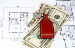 Key and money on home plan Stock Images